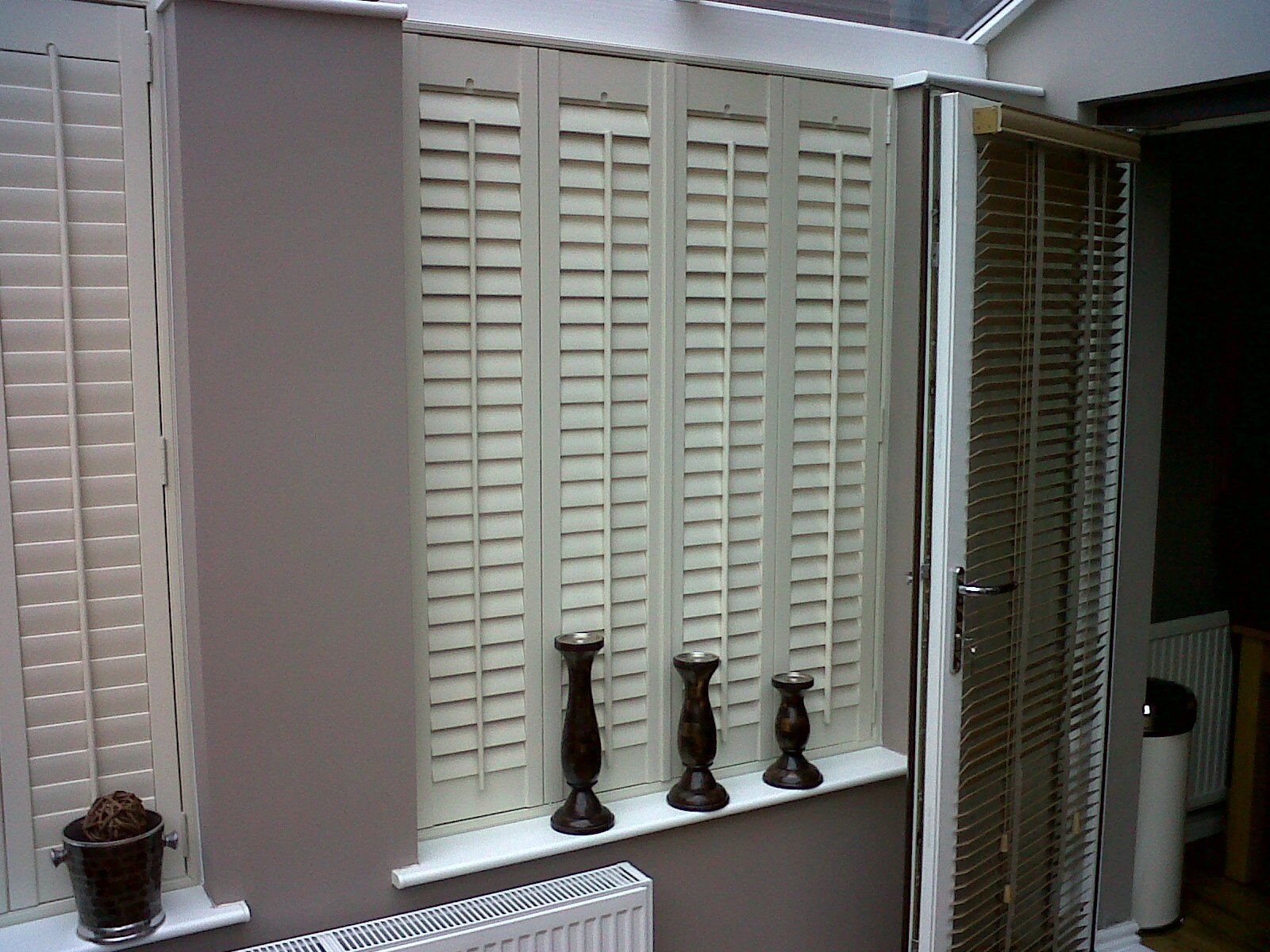 Window shutters manchester shutter boutique for Interior window shutter designs